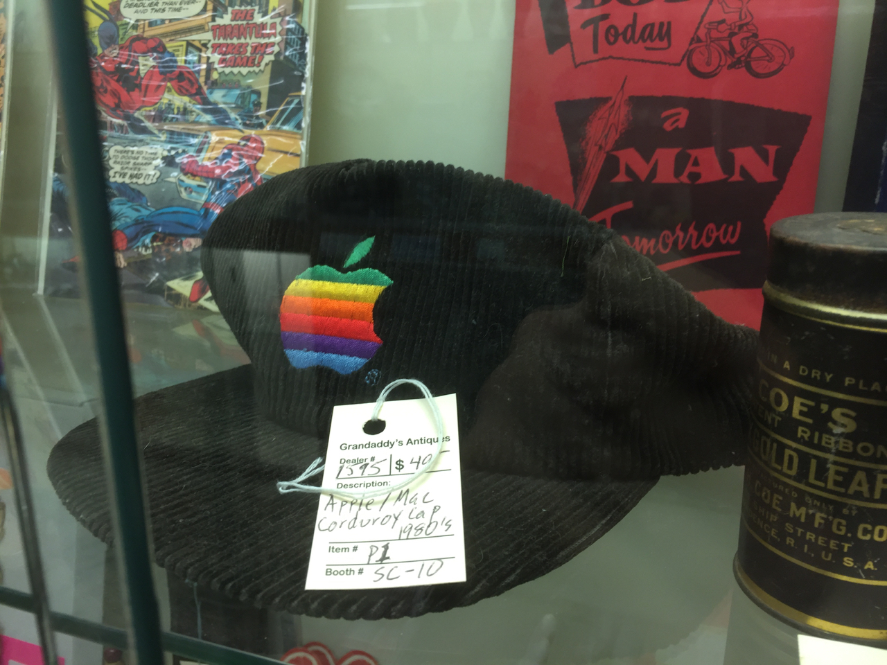 an Apple hat