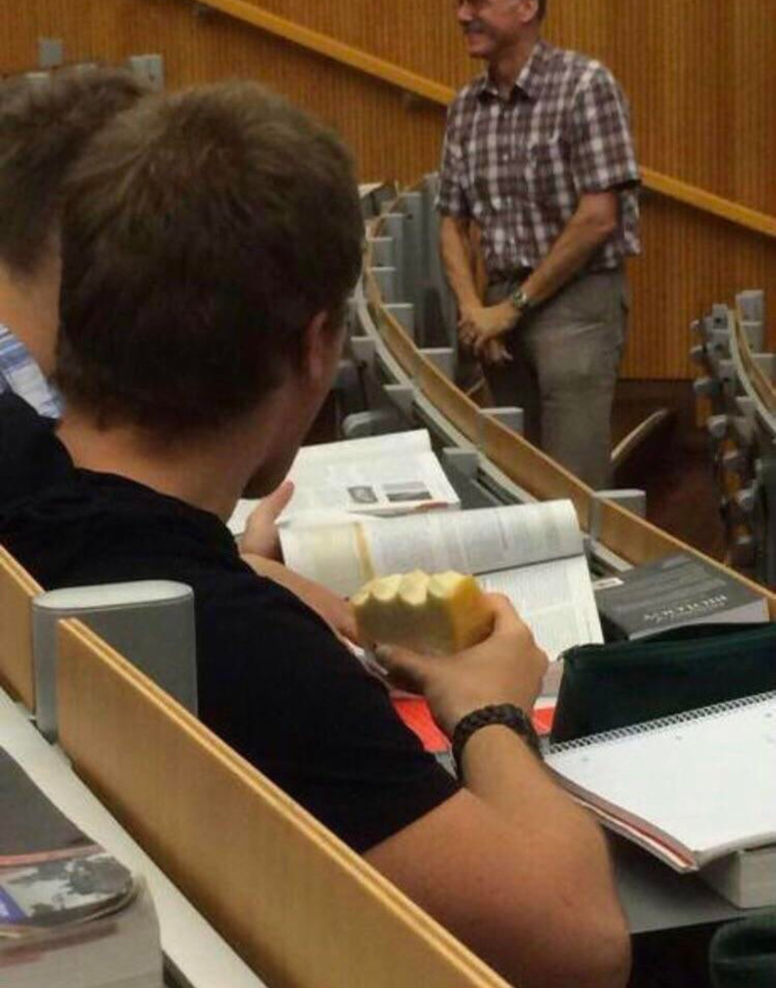 Eating a cheese wheel in class